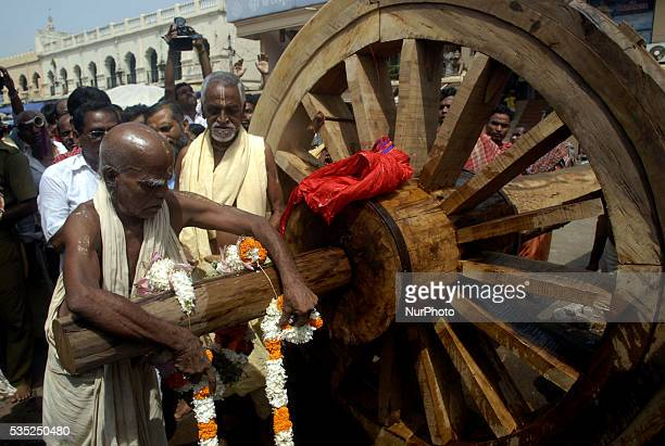 Temple sevayat or traditional chariot makers offer rituals to the newly built wooden wheel of Lord Jagannath Balabhadra and Devi Subhadras chariot...