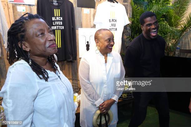 Temple University Archivist Leslie WillisLowry New York University Professor Deborah Willis and Darius Turner the Black Lives Matter booth at PRIZM...
