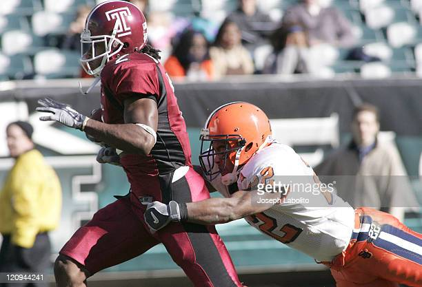 Temple wide receiver Buchie Ibeh is caught from behind by Syracuse defensive back Diamond Ferri during Temple Owls vs Syracuse Orange at Lincoln...