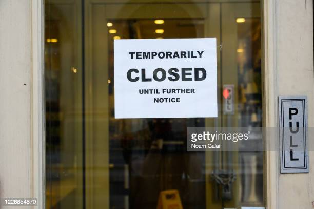 A 'Temporarily closed' sign is posted outside a food establishment during the coronavirus pandemic on May 24 2020 in New York City Government...