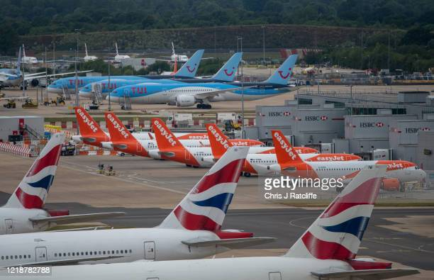 Temporarily out of use British Airlines, EasyJet and TUI aircraft at Gatwick Airport on June 9, 2020 in London, England. Gatwick Airport has...
