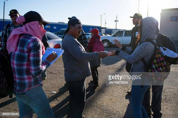 A temporary agricultural worker gets a daily advance on her paycheck after getting off a bus as she returns to the Port of Entry in San Luis Arizona...
