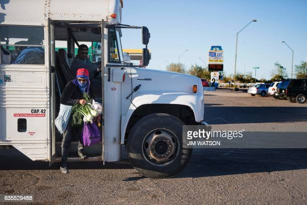 Temporary agricultural worker gets off a bus as she returns to the Port of Entry in San Luis, Arizona, on February 15, 2017. Attention Editors, this...