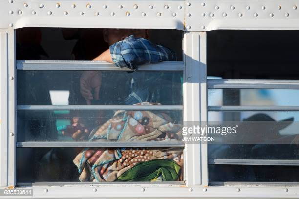 Temporary agricultural worker looks out the window of a bus near the Port of Entry in San Luis, Arizona, on February 15, 2017. Attention Editors,...