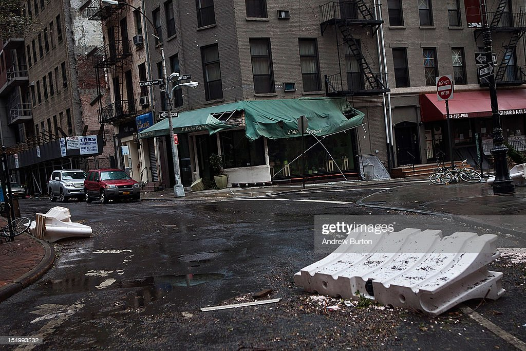 Temporary barriers lay in a street following Hurricaine