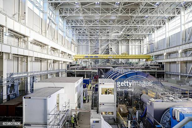 Temporary cabins stand inside the turbine hall as construction work continues on the Evolutionary Power Reactor nuclear power plant operated by...