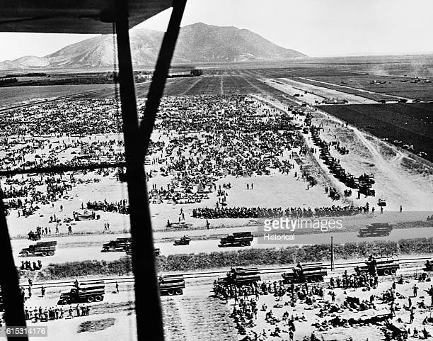 A temporary camp holds thousands of German and Italian prisoners including men from the Afrika Korps after the Allies' takeover of Tunisia in May...