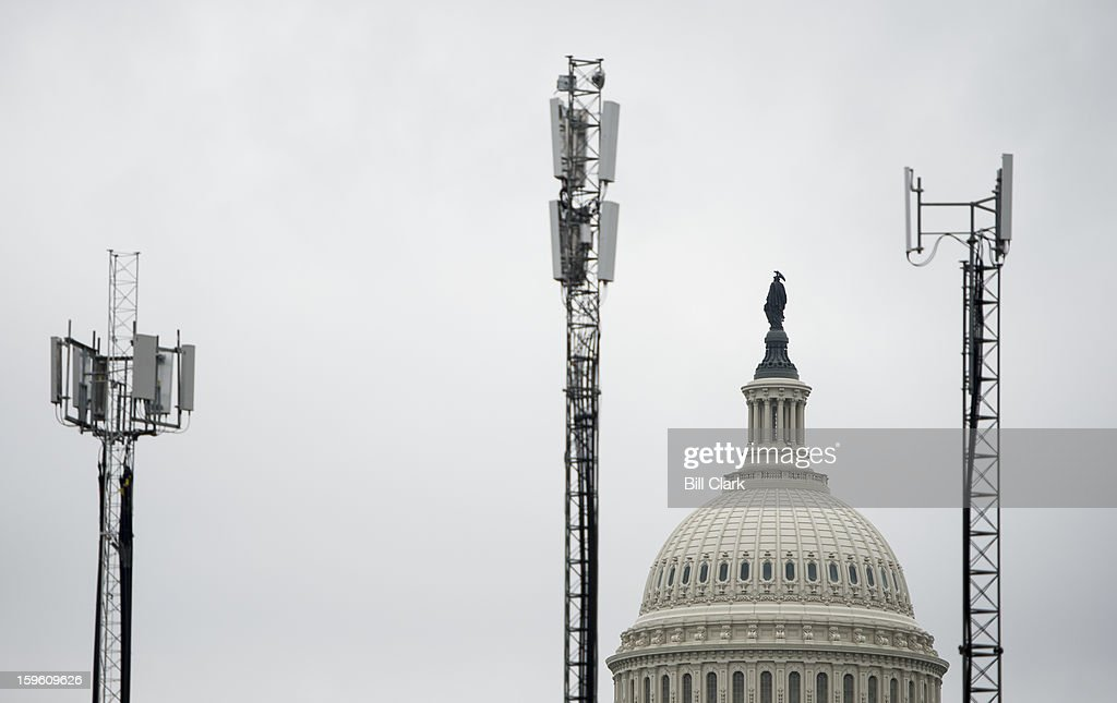 Temporary cell phone towers stand on the Capitol grounds along Constitution Ave. NW in Washington on Wednesday, Jan. 16, 2013, in preparation for President Barack Obama's inauguration.