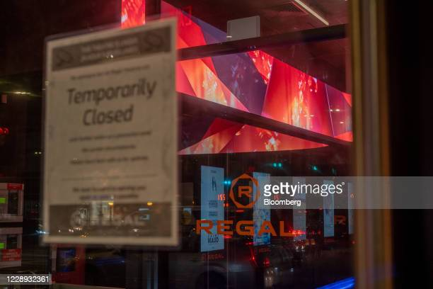 Temporary Closed' sign is displayed at a Regal Cinemas movie theater in Lower East Side of New York, U.S., on Tuesday, Oct. 6, 2020. More than 7,000...