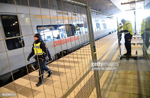 A temporary fence is erected between domestic and international tracks at Hyllie train station in southern Malmo Sweden on January 3 to ease border...