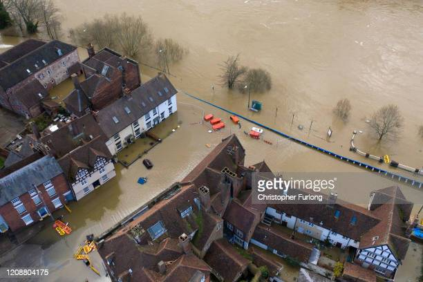 Temporary flood barriers are overwhelmed by flood water from the River Severn on February 26, 2020 in Bewdley, England. Shrewsbury, Worcester and...