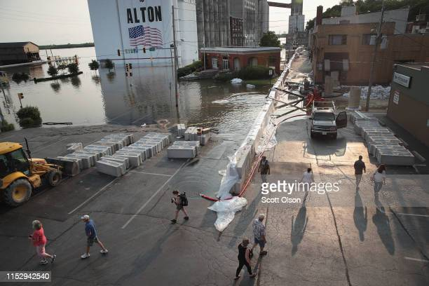 A temporary floodwall along Highway 100 holds back floodwater from the Mississippi River in the historic downtown area on May 31 2019 in Alton...