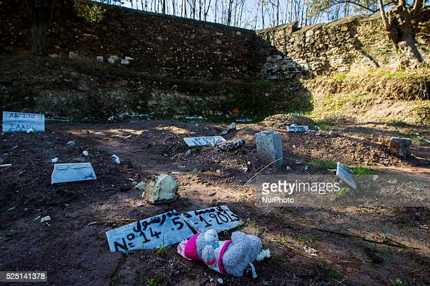 Temporary headstones marks the graves of migrants and refugees who died attempting to cross from Turkey to the Greek island of Lesbos after their...