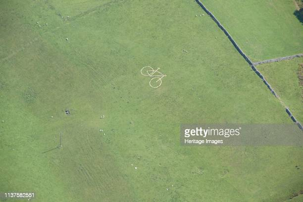 Temporary hill figure of a bicycle to mark the route of the Tour de Yorkshire Grand Depart, Worton, North Yorkshire, 2014. Artist Historic England...