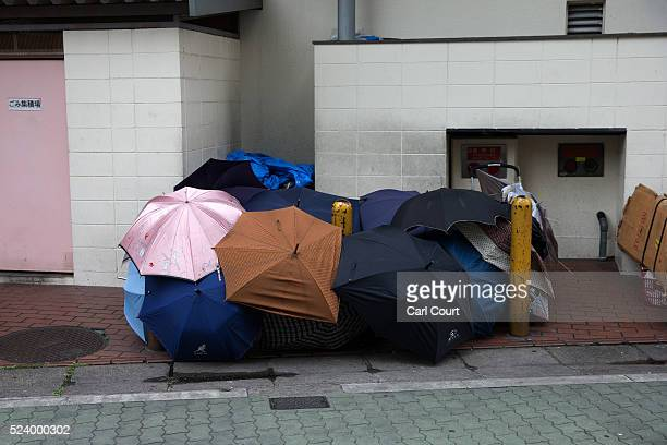 A temporary home made of umbrellas is pictured in the slum area of Kamagasaki on April 23 2016 in Osaka Japan Kamagasaki a district in Japan's second...