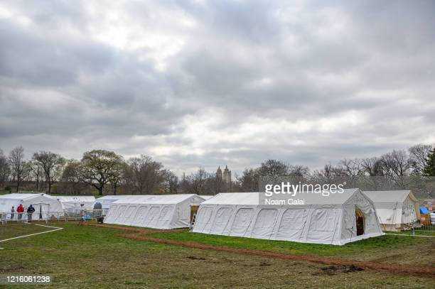 A temporary hospital is built in Central Park on the East Meadow lawn during the Coronavirus pandemic on March 31 2020 in New York City The facility...