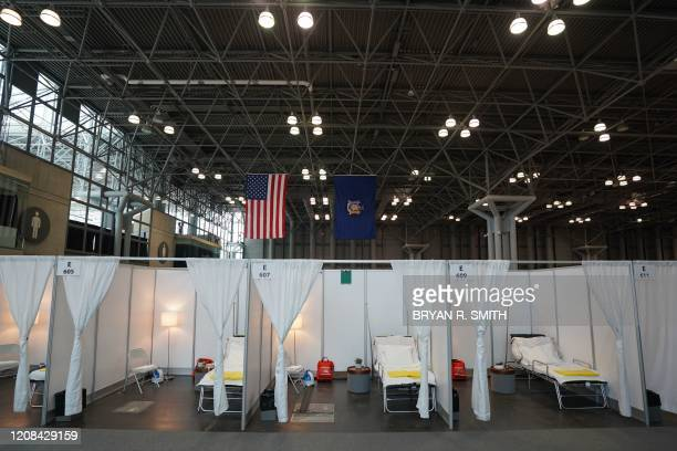 TOPSHOT A temporary hospital is set up at the Jacob K Javits Center on March 27 2020 in New York The New York National Guard the US Army Corps of...