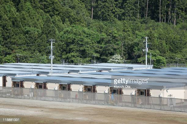 Temporary houses built for evacuees after the March 11 earthquake and tsunami are seen in a row on June 11 2011 in Minamisanriku Miyagi Japan...