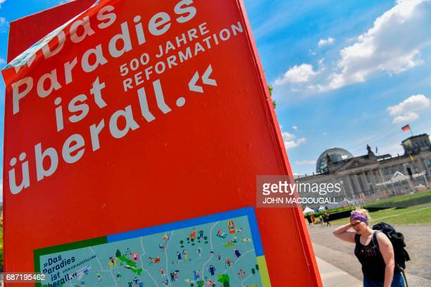A temporary information booth stands in front of the Reichstag building ahead of the Kirchentag festival celebrating the 500th anniversary of the...