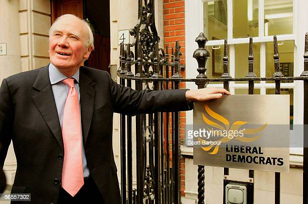 Temporary leader of the Liberal Democrats Menzies Campbell poses next to the Party's logo outside their headquarters on January 10 2006 in London...