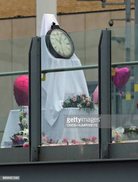 A temporary memorial covered in flowers and balloons lies on a walkway linking Manchester Arena to Manchester Victoria Station on May 30 2017 in...