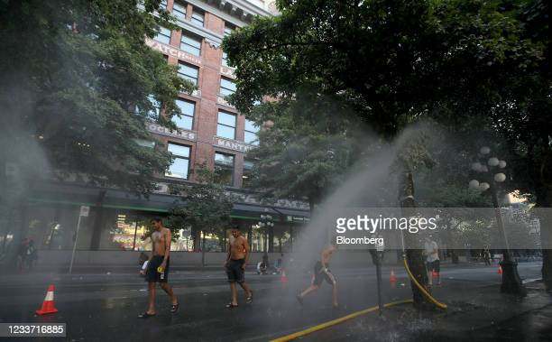 Temporary misting station on Abbott Street during a heatwave in Vancouver, British Columbia, Canada, on Monday, June 28, 2021. The heat is expected...