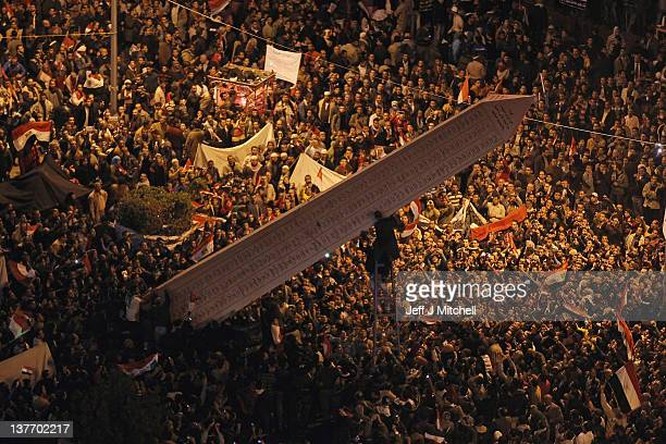 Temporary monuments are erected in Tahrir Square as thousands of Egyptians gather to mark the one year anniversary of the revolution on January 25...
