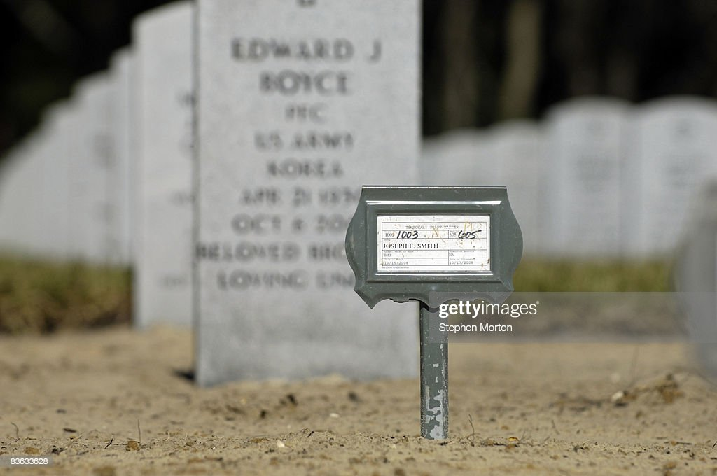 A temporary name tag marks the grave of a veteran at the