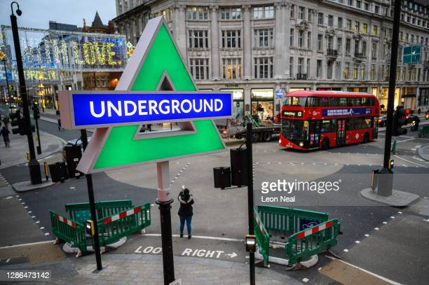 Temporary replacements for the traditional Transport for London roundels at Oxford Circus station showing the Playstation button designs are seen as...