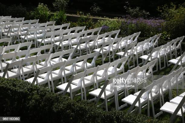 temporary seating for a outdoor commencement - graduation background stock pictures, royalty-free photos & images