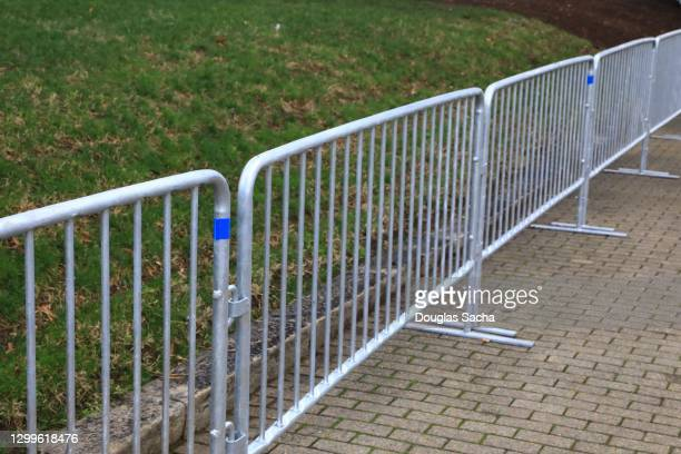temporary security barrier outside a government building to prevent political unrest - 仮の ストックフォトと画像