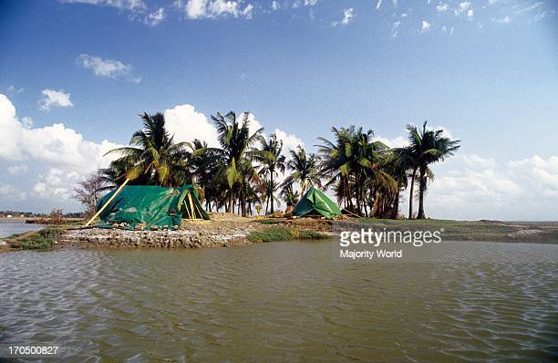 Temporary shelters for the cyclone affected people on the bank of Sangu river in Banshkhali upazila of Chittagong district in Bangladesh 1991 The...