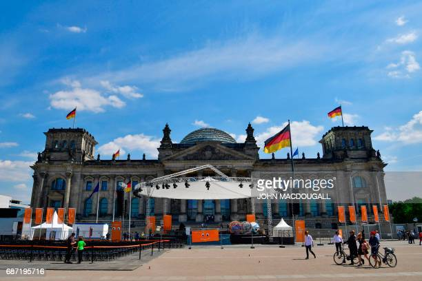 A temporary stage where mass will be celebrated stands in front of the Reichstag building ahead of the Kirchentag festival celebrating the 500th...