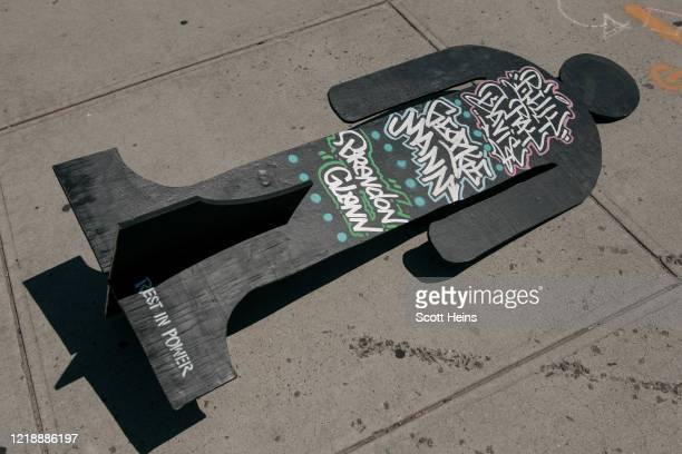 Temporary statue bearing the names of people killed by police lays on the sidewalk on June 9, 2020 in the Bedford Stuyvesant neighborhood of the...