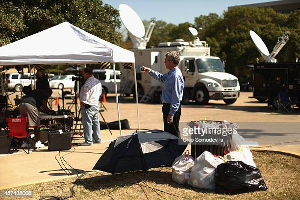 Temporary television stand-up studios and satellite trucks remain in a parking lot outside Texas Health Presbyterian Hospital October 18, 2014 in...