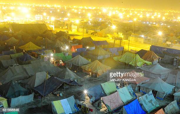 TOPSHOT Temporary tents for devotees are pictured at Sangam the confluence of the rivers Ganges Yamuna and the mythical Saraswati during the Magh...