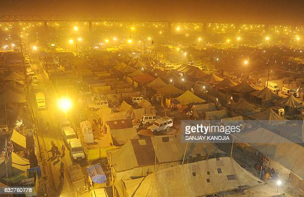 TOPSHOT Temporary tents for devotees are pictured at Sangam the confluence of the rivers Ganges Yamuna and the mythical Saraswati on the eve of...