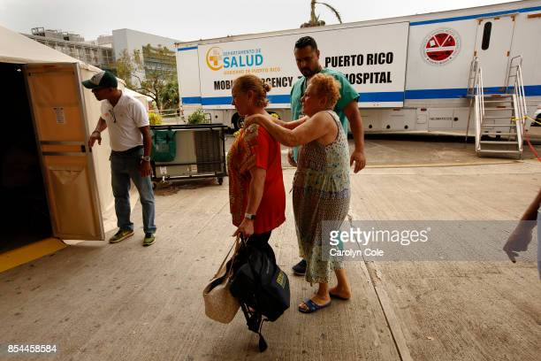 Temporary triage tents were set up outside the Centro Medico Puerto Rico to help with the overflow of patients and to house the mobile emergency...