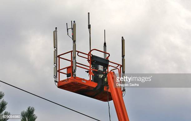 Temporary wireless phone antenna attached to a construction platform