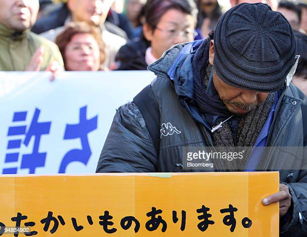 Temporary worker who lost his job and home attends a rally in Tokyo, Japan, on Monday, Jan. 5, 2009. Homeless and suicide numbers in Japan may spike...