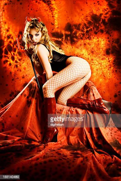 temptating she-devil in hell. - devil costume stockfoto's en -beelden