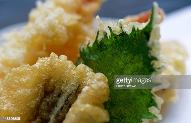 tempura shiso (perilla) leaf from the yamadaya udon shop in shikoku. tempura was not originally japanese, it was brought with the visiting portuguese missionaries of the 16th century. - shiso stock pictures, royalty-free photos & images