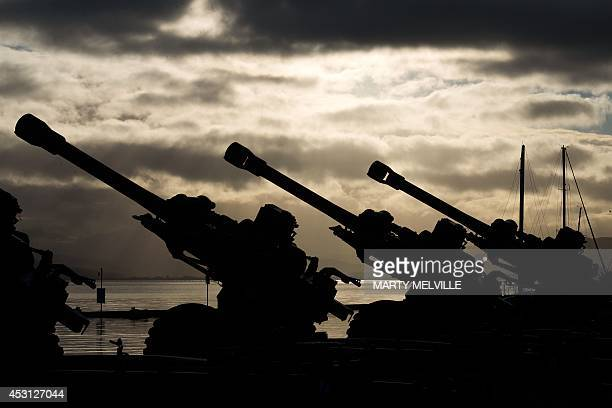 Ten 105mm Howitzers sit silent waiting for the personnel from 16th Field Regiment of the Royal Regiment of New Zealand Artillery to fire a 100gun...