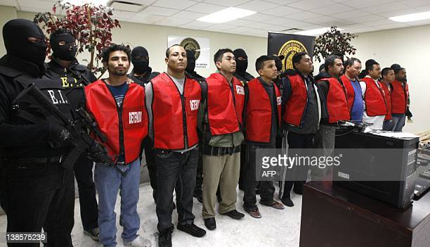 Ten alleged members of Los Zetas drug cartel are presented to the press in Monterrey Mexico on February 9 2012 More than 40000 people have been...