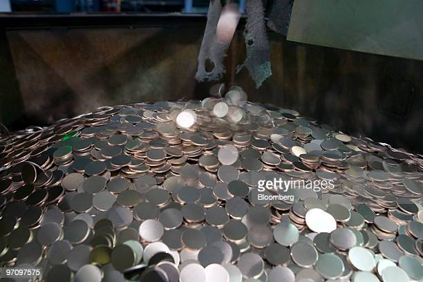 Ten cent blanks fill a bin prior to being struck at the United States Mint in Philadelphia Pennsylvania US on Thursday Feb 25 2010 The US dollar has...