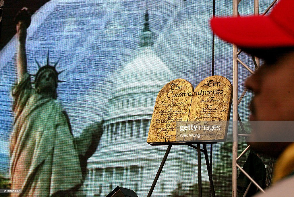 A Ten Commandment plaque is displayed on the stage during the 'America for Jesus' rally October 22, 2004 at the National Mall in Washington, DC. Although the U.S. Constitution prohibits an official state religion, references to God appear on American money, the U.S. Congress starts its daily session with a prayer, and the same U.S. Supreme Court that has consistently struck down organized prayer in public schools as unconstitutional opens its public sessions by asking for the blessings of God. The Supreme Court will soon use cases from Kentucky and Texas to consider the constitutionality of the Ten Commandments displays on government property, addressing a church-state issue that has ignited controversy around the country.