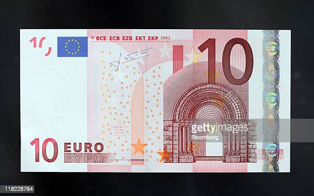 A ten euro note is arranged for a photograph in London UK on Tuesday July 5 2011The euro dropped for the first time in seven days versus the...