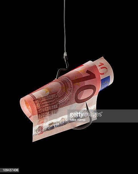 Ten euro note on fishing hook