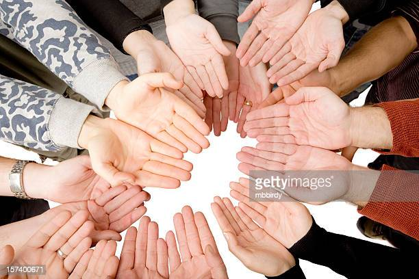 Ten people putting hands together