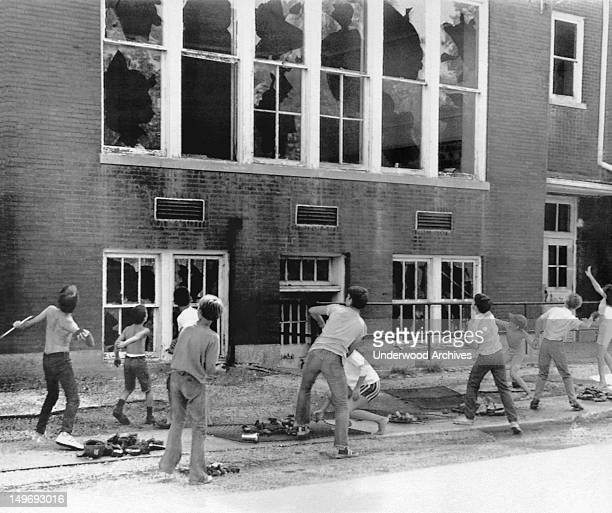 Ten school children caught in the act of breaking windows at their school East Alton Illinois August 13 1971 As the school was to be torn down they...